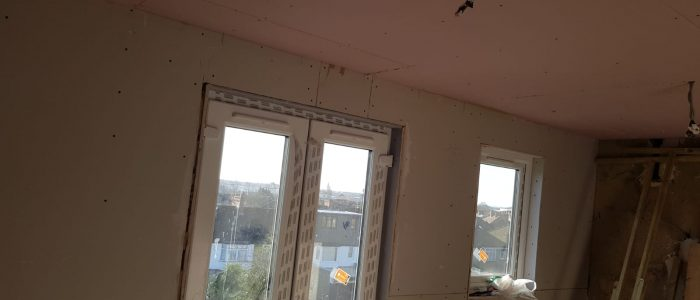 Hip to Gable loft conversion - Plasterboard and windows installed